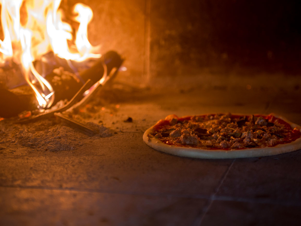 Hot fire oven with pizza baking